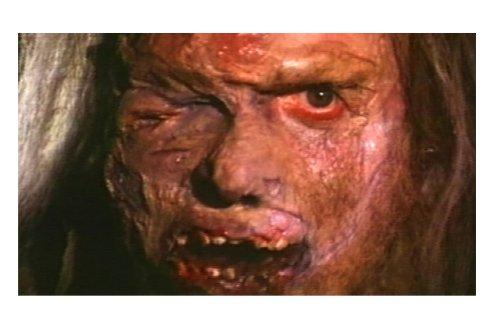 放射能汚染によってケロイド状になったグロテスクな父親の顔。
