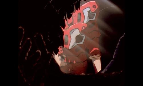 黒焦げとなったレイの手(綾波レイの黒焦げ死体)がうっすらと見える。
