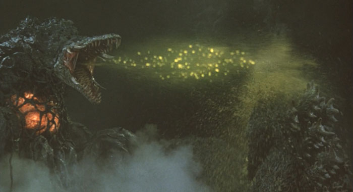 口から黄色い酸性樹液をゴジラに浴びせるビオランテ