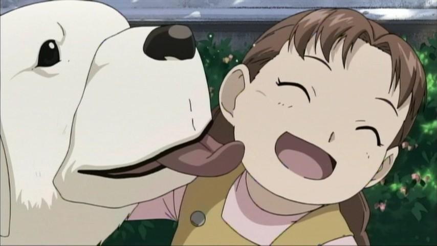 タッカーの実の娘ニーナ・タッカーと飼い犬のアレキサンダー