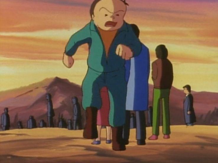 浜本「お、おれ・・・、嫌だ・・・。」 浜本「母ちゃんも父ちゃんもいないところで死ぬなんて…、ひ、ひとりで死ぬなんて!!」 浜本「い、いやだぁー!!いやだああああ!!!」 近くにいた人々が浜本を制止する。彼らもまた人間爆弾になってしまった者達である。